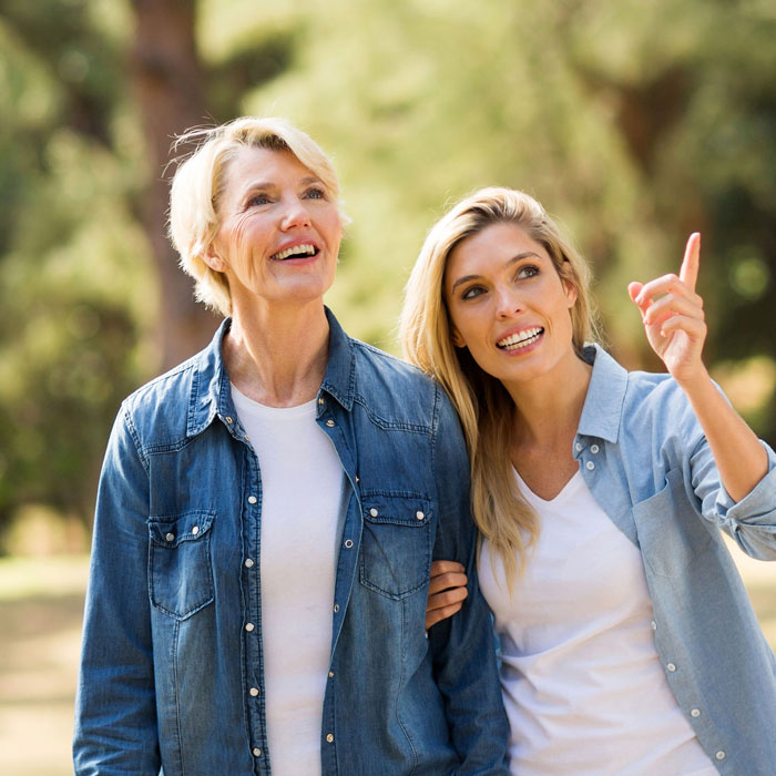 two people smiling, and one pointing
