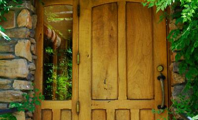 front door with surrounding greenery
