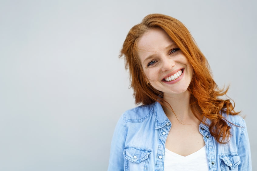 teeth whitening in Prescott AZ - Sincere young woman with a lovely smile - person smiling