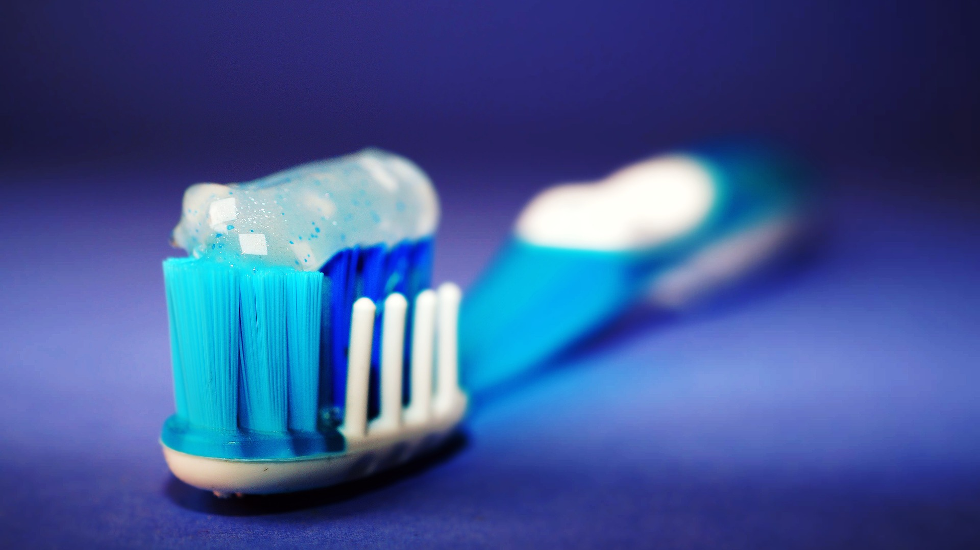 toothbrush care - toothbrush with toothpaste on it