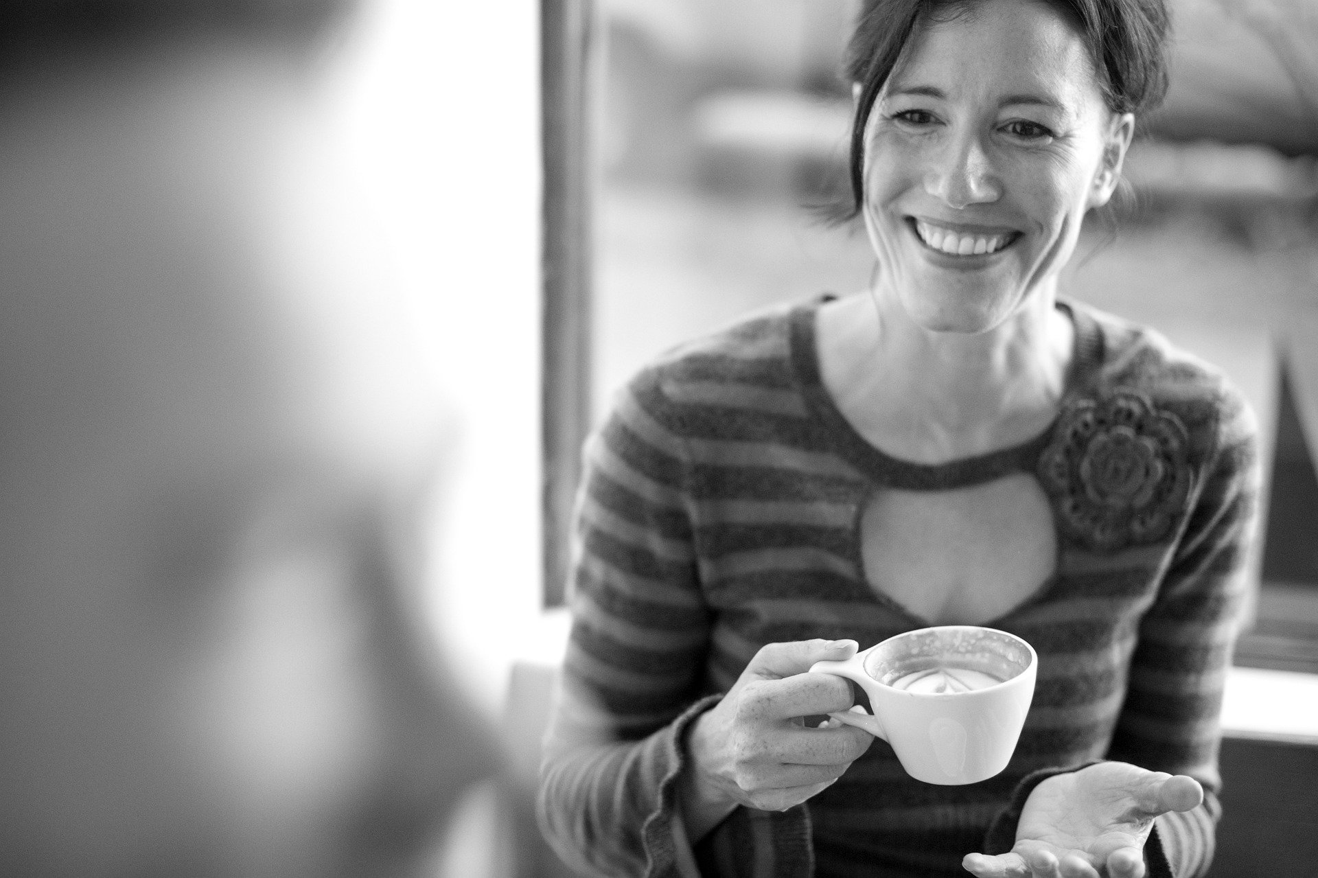 woman drinking coffee - natural teeth whitening
